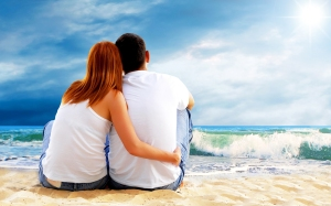 bigstock-Sea-view-of-a-couple-sitting-o-14245655
